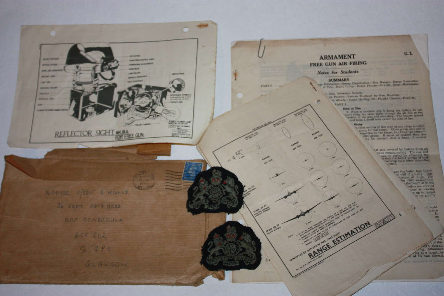 A SMALL COLECTION OF RAF PAERWORK AND BADGES SEE PICS