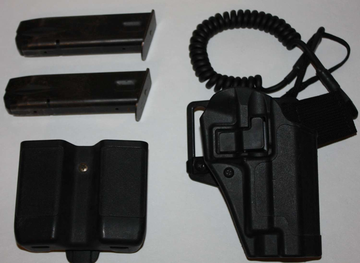 A BLACKHAWK CQC PISTOL HOLSTER AND MAG POUCH WITH 2 SIG SAUER CLIPS