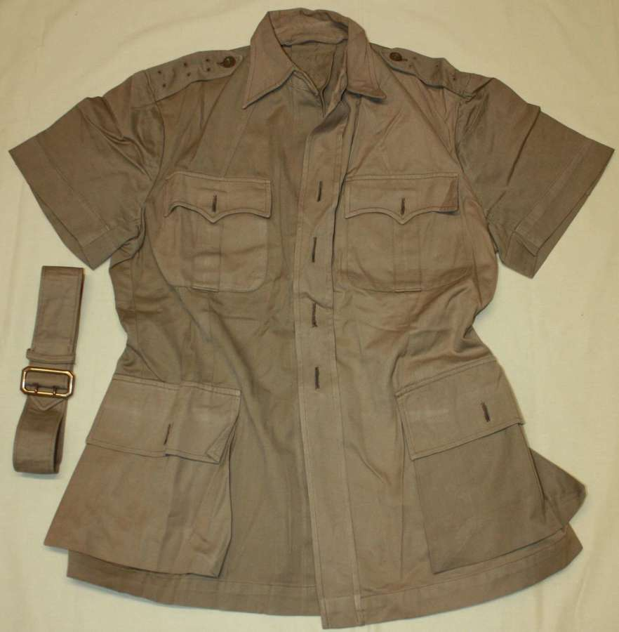 A WWII PERIOD TROPICAL OFFICERS BUSH JACKET